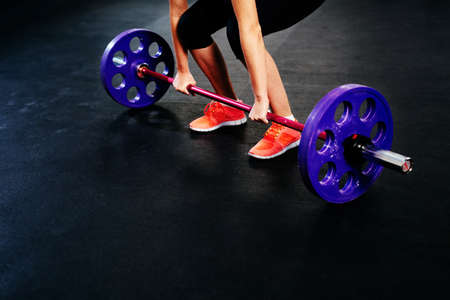 Closeup of woman training deadlift at gym Stock Photo