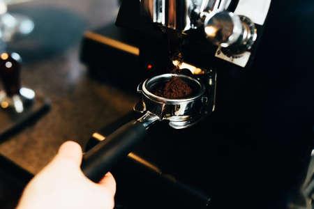 Barsita grinding coffe for espresso