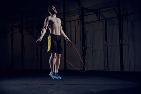 Portrait of young male athlete skipping rope Reklamní fotografie - 96002574