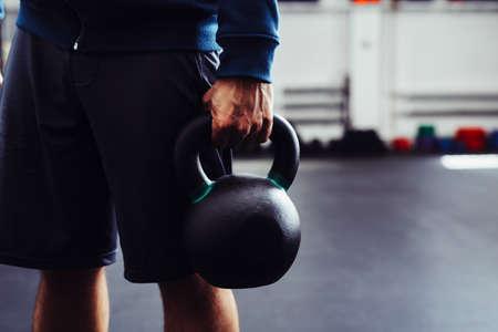 Strong man holding kettlebell