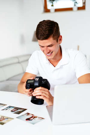 Portrait of young photographer editing pictures