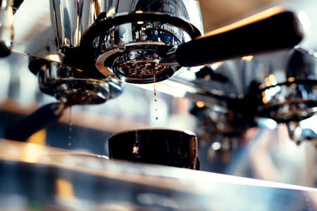 Closeup of espresso pouring from coffee machine