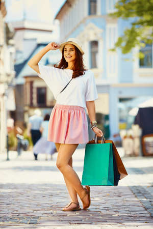 Happy young woman shopping during vacation Stock Photo