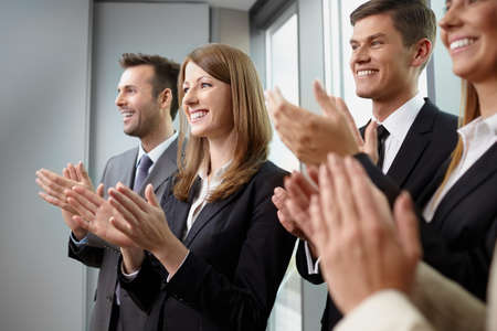 Group of business people clapping hands. Business seminar concept Фото со стока