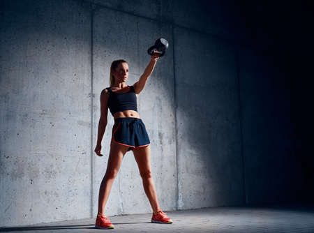 Young woman doing kettlebell swing exercise Stock fotó - 96490651