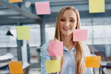 Creative young woman working at office planning company strategy