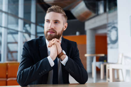 Confident young businessman looking away