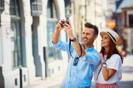 Tourists taking photo in the city Foto de archivo