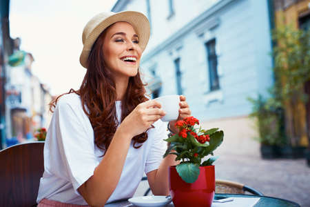 Attractive woman drinking coffee in the city