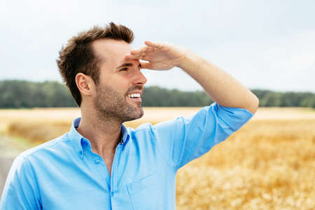 Portrait of a young happy man looking ahead Stock Photo