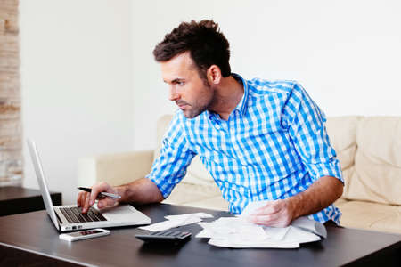 Young man checking home finance
