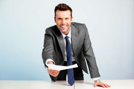 Young manager handing in a contract Stock Photo