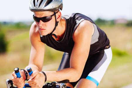 Triathlon sportsman speeding on a bike