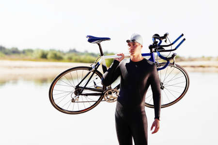 Triathlonist preparing for the bike race