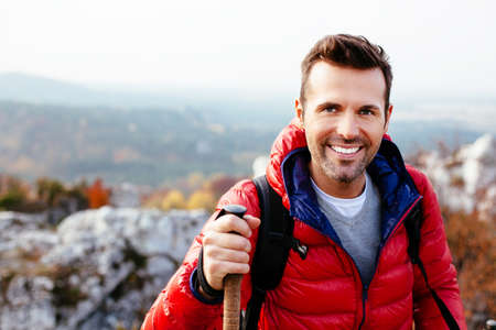 Portrait of a young man hiking in the mountains