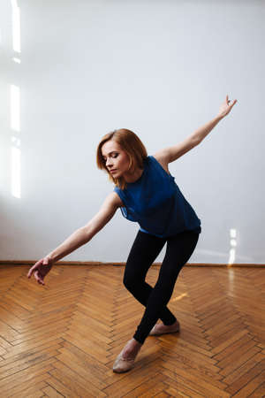 Female ballet dancer stretching her arms in a balanced move