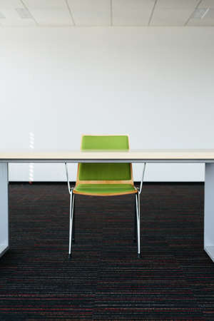 Photo of an empty office room with a desk and chair Stock Photo