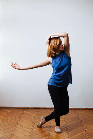 Female dancer perfecting dance moves