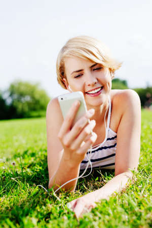 Portrait of a pretty woman enjoying her time in the park Stock Photo