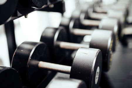 Closeup of dumbells in a gym