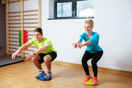 Young positive people in proprioception training session Standard-Bild
