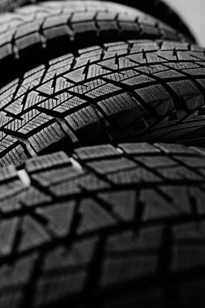 Stack of snow tires. Abstract background image 写真素材