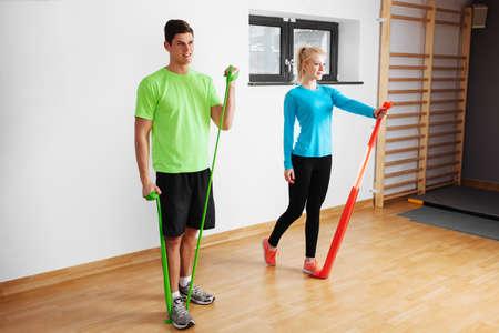 Young couple doing isometric exercises