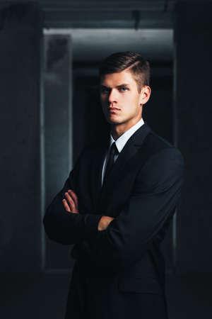 Portrait of a decisive professional against a concrete background