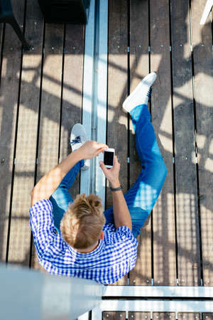Birds eye photo of a texting young man Stock Photo