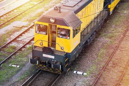 freight train: Yellow freight train from above in sunlight. Raylway infrastructure in Europe. Stock Photo