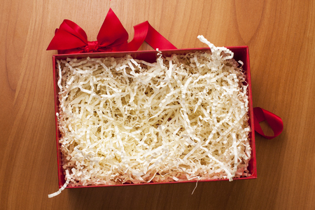 Christmas opened empty gift box. Paper strips filler for gift wrapping. Banco de Imagens