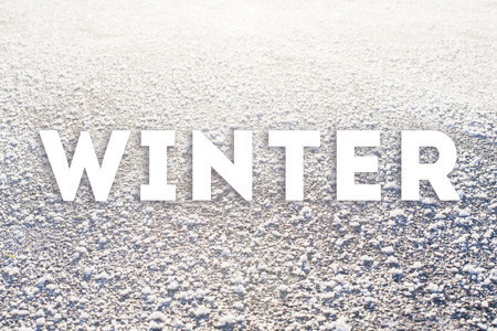 Winter text on frozen surface. Cold weather poster
