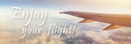 Enjoy your flight text on sky and aircraft wing panorama, wide size 스톡 콘텐츠