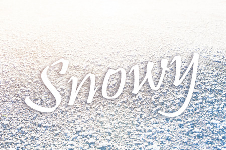 Snowy text on frozen surface texture 스톡 콘텐츠