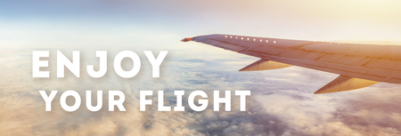 Enjoy your flight text on sky background with airplane wing. Ready airlines advertisement 스톡 콘텐츠