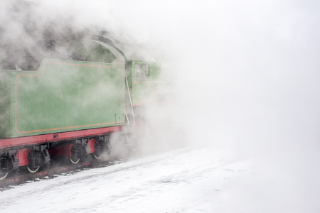 Clouds of vapor around the green steam train. Vintage techic for good ecology 스톡 콘텐츠