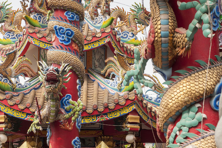 Thai buddhist temple close up. Asian dragons texture in architecture.