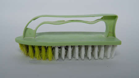 Multi-purpose plastic laundry brush old stock color green Banque d'images