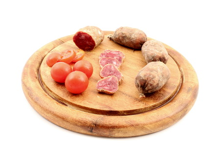 meats: Meats with tomatoes over cutting board