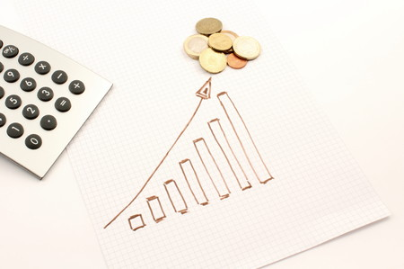 statistician: Diagram shows designed coins, the calculator instrument. Stock Photo
