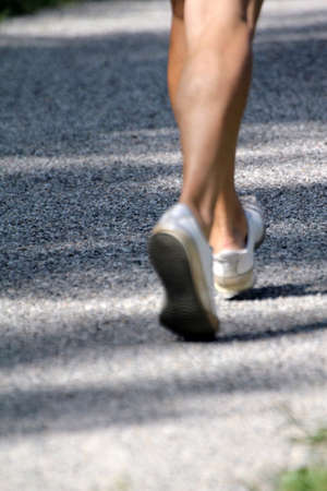 Feet of athlete running on the road, out of focus  photo