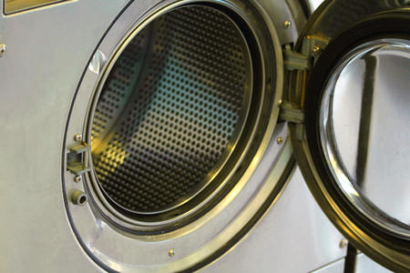 Stainless steel basket, open a washing machine  photo
