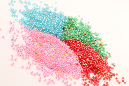tilted view: Plastic granules united colors of four tilted view