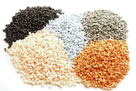 extrusion: Colored plastic granules for extrusion work. Stock Photo