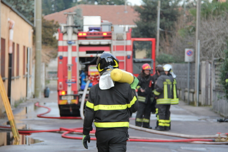 Fireman in action during the fire - Italy Standard-Bild