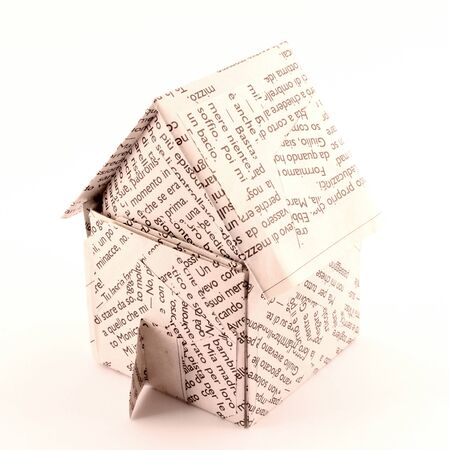 A paper house built with a sheet of paper printing Italy.