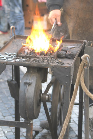 beating: Craftsman working with fire beating iron. Stock Photo