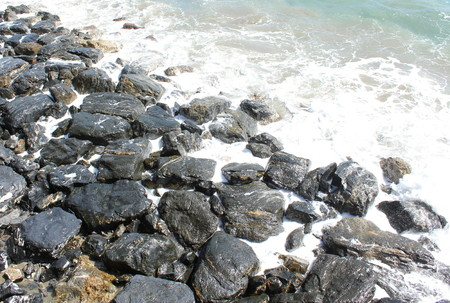 overhang: Nature marina with rocky beach with the situation rough sea.
