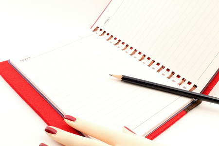 legal pad: A legal pad secrets with a woman39s hand and pencil white background. Stock Photo