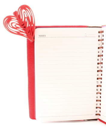 legal pad: A legal pad secrets, with a red heart, white background. Stock Photo